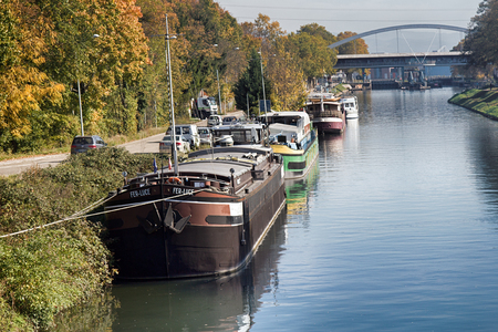 Strassburg, France - September 22, 2017: quays of during spring and summer - abundance of moored houseboats (residential barges)
