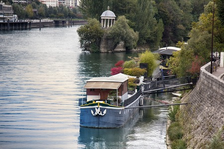 Paris, France - September 22, 2017: quays of Paris during spring and summer - abundance of moored houseboats (residential barges) Editorial