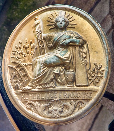 Limoges, France - September 28, 2017: Architectural details on building, aesthetic frills. Allegory of French Republic - women freedom, seal of Second Republic, Laurel crown with seven rays of liberty
