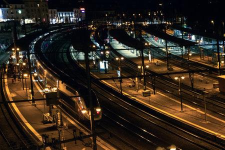 Large terminal railway passenger traffic in evening hours. Maintenance of high-speed trains, suburban train Editorial