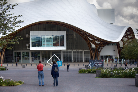 Metz, France - September 20, 2017: contemporary art museum - Le centre Pompidou-Metz. Ultra-modern architecture, conical floating roof. Space planning (see perspective of human figures on square) Stockfoto - 103272145