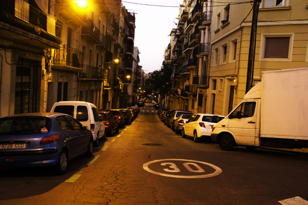 Spain, Barcelona - October 8, 2017: Evening in old quarter, residential building of classical architecture, abundance of balconies to hear serenades but solid Parking