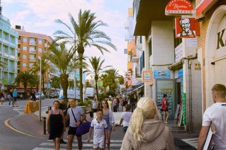 Spain, Lloret de Mar - October 2, 2017: boardwalk, promenade, street, bridge, palm trees, hotels, tourists, citizens. Mediterranean resort
