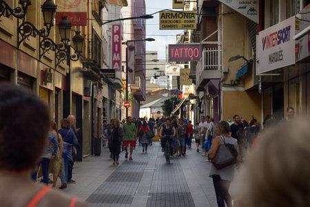 Spain, Lloret de Mar - October 2, 2017: boardwalk on beach, promenade, bridge, palm trees, hotels, tourists. Mediterranean resort
