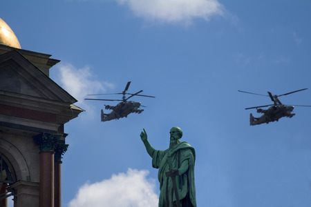 S-Petersburg, Russia - May 9, 2017: Mi-35. Military helicopter over figure of St. Peter. Then says Jesus to Peter put your sword back in its place because all who take the sword perish by the sword Editorial
