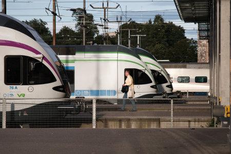 Helsinki, Finland - August 22, 2017: High-speed intercity trains on the passenger platform Editorial