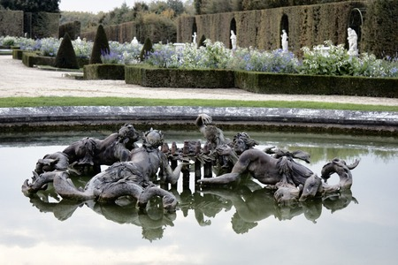 Versailles, France - September 26, 2017: four river nymphs fountain, Naiads. In background sculptural groups and flower beds, green fence 新聞圖片