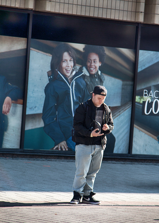 HELSINKI, FINLAND - AUGUST 24, 2017: Cultural Tolerance. Full-bodied teen on poster background with happy girls of different races Redactioneel