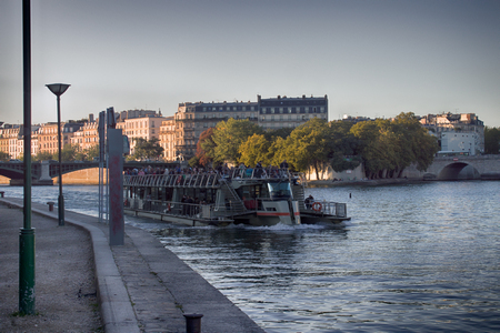 Paris, France - September 22, 2017: City tours on river Seine on pleasure boats Redakční