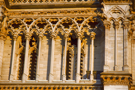 Notre Dame de Paris Cathedral Gothic style. Architectural details, Lancet Windows and tympana with curls, pilasters and moldings, clover 版權商用圖片