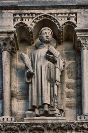 Notre Dame de Paris Cathedral Gothic style. Architectural details, Holy Stefan on the arch of judgment 版權商用圖片