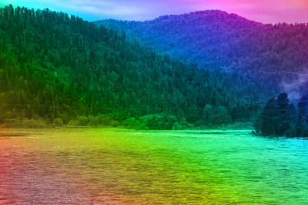 Picturesque landscape. Mountains, mountain lakes and mountain rivers in rainbow colors