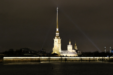 Festive, public holiday in Northern city Saint Petersburg. Cold brightening of building illumination and decorative string in harmony with climate. Peter and Paul (Petropavlovskaya) fortress