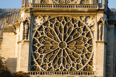 Notre Dame de Paris Cathedral Gothic style. Architectural details. Part of the South portal. Catherine-wheel - round window with sash-bars arranged along radii - figure of boundlessness and infinity
