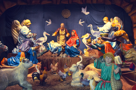 Christmas period, Christmas cribs, Nativity scene. Scene with volumetric figures of peoples and profiles of birds and animals