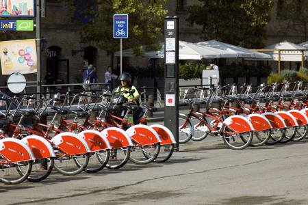 Barcelona, Spain - October 9, 2017: red public bikes, public transport in square 報道画像