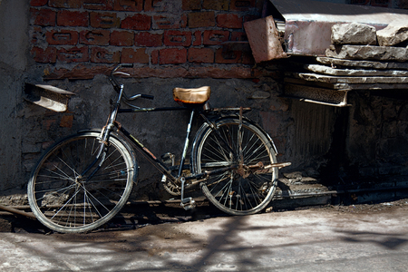 old bikes in deep space poor neighborhoods. urban transport for ordinary people. Stock Photo