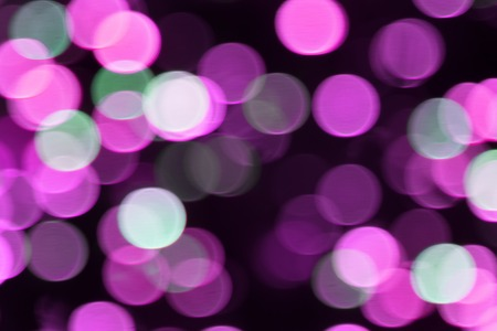 Color glare in form of circles. Glare from defocusing lights, roud speck, round spot. Multicolored highlights create festive mood, decorate photo. Color abstract painting. Night light from car