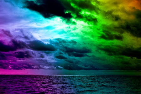 Seascape, sea view. Disturbing dramatic sky above winter sea. Contrasting colors of weather and sunset over sea. Torn Cumulus clouds in wind before storm, prethunderstorm sky, nebulosity Stock Photo