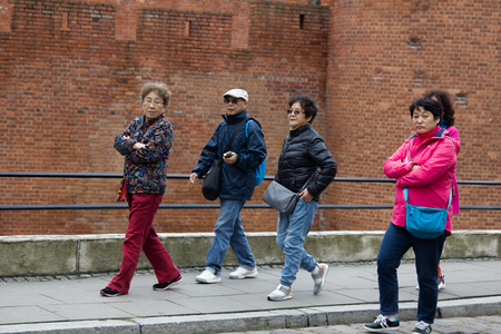 Warsaw, Poland - September 28, 2017: Daily life of the European city (citys day-to-day activities, daily routine). A group of tourists from Asia Redakční