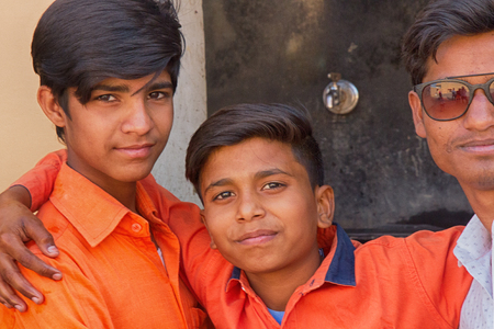 India, new Delhi - March 2, 2018: three young friends of Hindus. portrait