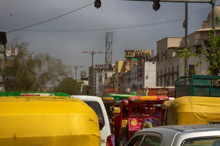 India, new Delhi - March 19, 2018: traffic flow from rickshaw and cars to market street Editorial