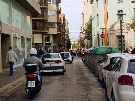 Spain, Girona - September 28, 2017: Daily life of the European city (city's day-to-day activities, daily routine). The streets and the citizens, transport