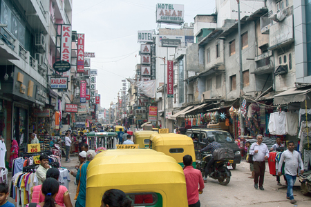 India, new Delhi - March 1, 2018: Indian street market main Bazaar Paharganj. day stream tricks taxi and buyers Hindus. Editorial