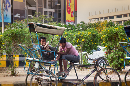 India, new Delhi-March 1, 2018: Indian bike taxi rickshaw rest. young Indians representatives of the ancient profession.