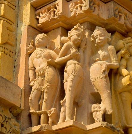 Glyptic, alto-relievo of Temples of Love in Khajuraho, Gods and companions of gods. Lakshmi, Parvati, Apsarases in tempting poses. Tantric practices and illustrations of Kama Sutra
