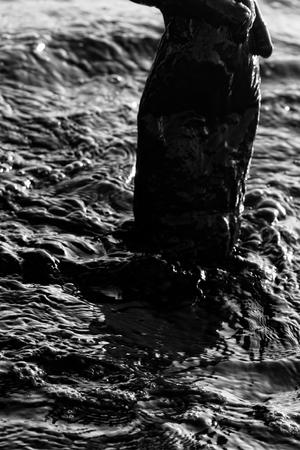 Amateur Spa treatment (mud baths, balneotherapeutic) is in a plastic bottle of mud (slush) from coastal mudflats saline lagoons, self-treatment. Very black color, blackness