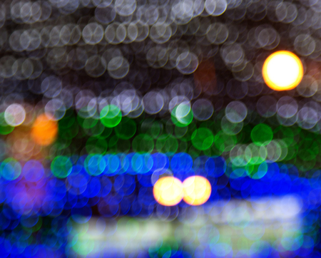 holiday bright bokeh blurred colorful background. Christmas colors in light spots. blurred 免版税图像