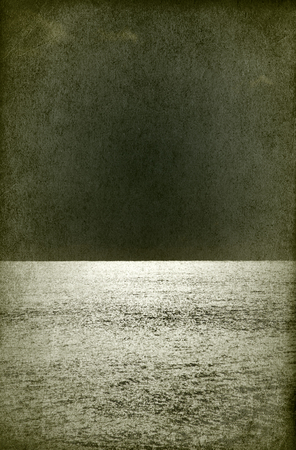 Moonlit night on the silvery sea from an old black and white photo, moon glade. Retro night