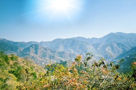 Lesser Himalayas. Mountain landscapes of spring time with peaks and ridges in the blue distance