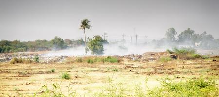 Indian village dump is burning 版權商用圖片