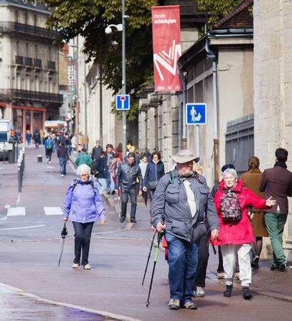 Dijon, France - 15.09.2017: tourists and citizens on the streets, senior citizen on a walk - heel-and-toe walk 報道画像