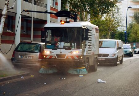 Lion, France - 14.10.2017: Process of cleaning street with a modern cleaning machine on the streets of a big city in Europe