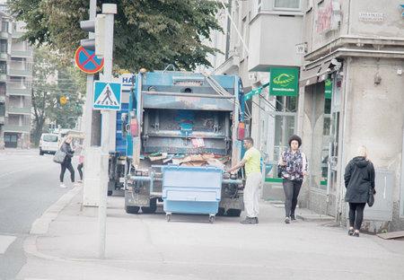 HELSINKI, FINLAND - AUGUST 21, 2017: garbage truck garbage collection process in Scandinavia
