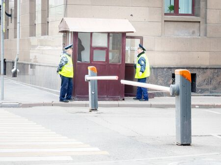 Moscow, Russia - may 3, 2019: roadblock with a barrier and security guards