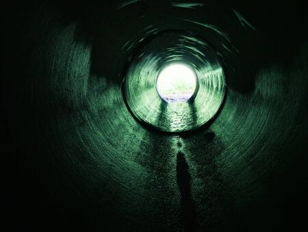 Drainage pipe under the highway (culvert). Filming inside the pipe.