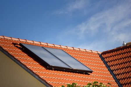 Houses of old construction with new tiled roofs and solar panels