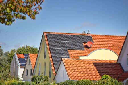 Houses of old construction with new tiled roofs and solar panels Stock Photo