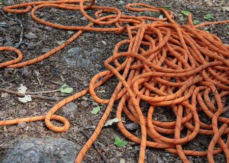 Climbing rope on ground among stones. A very strong rope to withstand the weight of any person