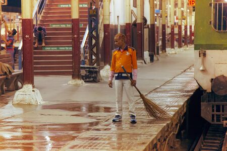 India, new Delhi - March 19, 2018: A sweeper at the Central station in uniform