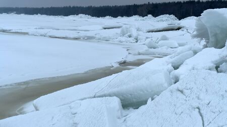 Huge ridge of ice hummocks after a powerful winter storm. Climate and weather change