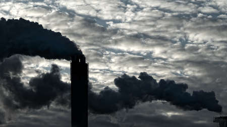 Thick clouds of dirty smoke from plant pollute atmosphere. Problems of planet pollution and global warming