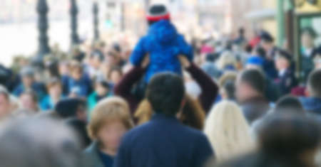 strong blurred, crowds of anonymous people on a city holiday in metropolis