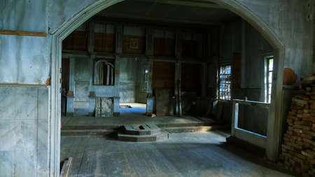 Abandoned Orthodox (Old Belief) Church in Arkhangelsk region, abominatio desolationis. In Church continue to walk individual old parishioner, icon, eight-pointed cross was used by Old Believer Stock Photo