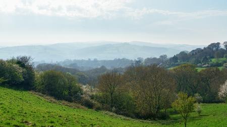 Idyllic rural view of English patchwork farmlands and beautiful surroundings in Devon, England 版權商用圖片