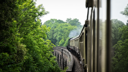 steam old train on aqueduct bridge. united kingdom.